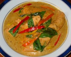 Poached salmon in red curry sauce