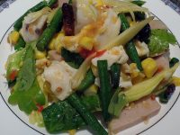Cooked corn with raw mango, raw green bean, carrot, chinese celery leaves, preserved northern style and mixed seafood with spicy Thai salad dressing.