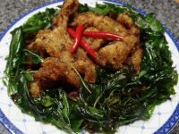 Crispy fried white fish coated with green curry sauce. Garnish with crispy Thai basil.